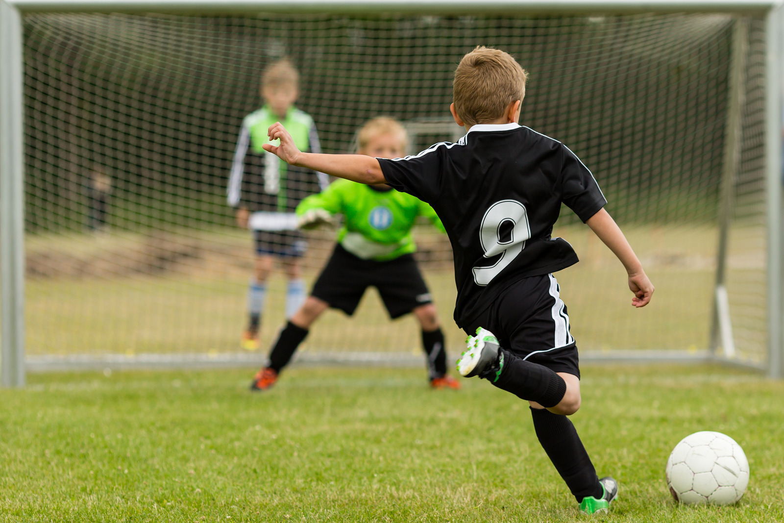playing sports kid burned kick indications soccer penalty intense comments